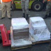 Bajo militarización llevan boletas electorales área de logística JCE